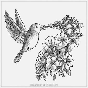 Desenho lindo pássaro com flores