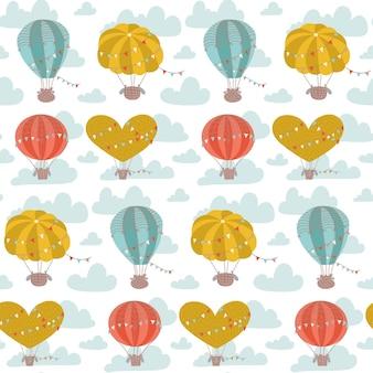 Desenho plano sem costura padrão com balões de ar quente, bandeiras e nuvens de fundo vector bonito para crianças