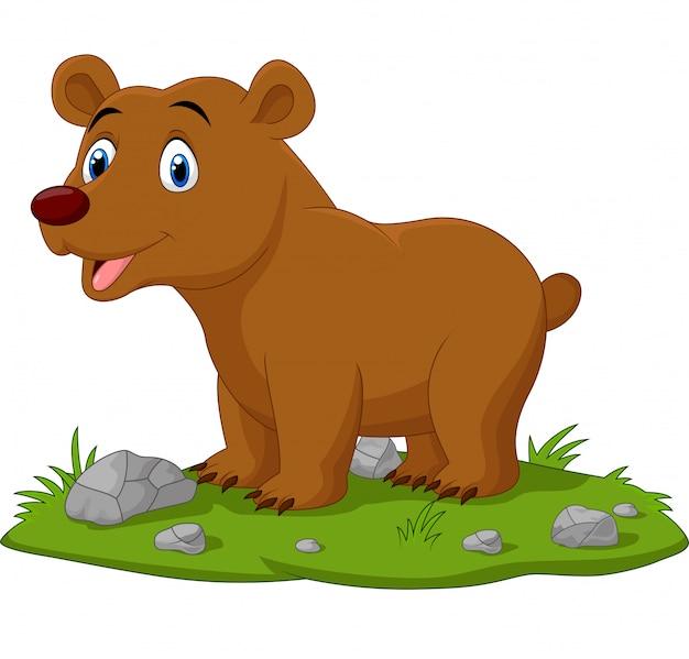 Desenhos animados bebê feliz urso na grama