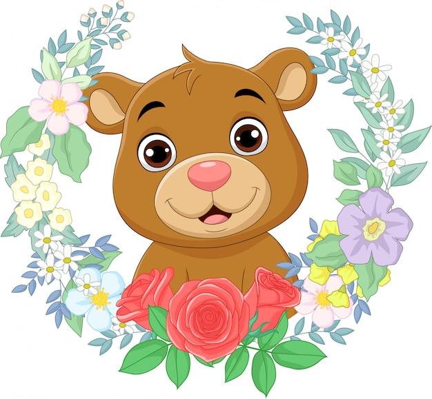 Desenhos animados bebê urso com fundo de flores