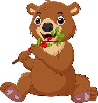 Desenhos animados bebê urso marrom com amora vermelha