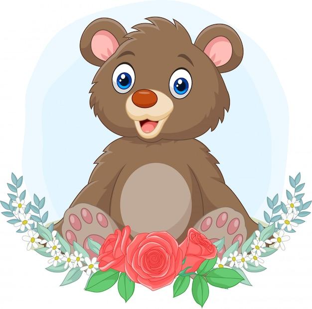 Desenhos animados bebê urso sentado com fundo de flores