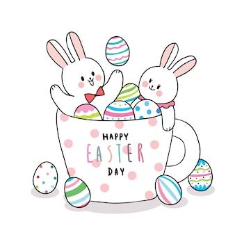 Desenhos animados bonitos coelhos do dia de páscoa e ovos coloridos em uma xícara de café.