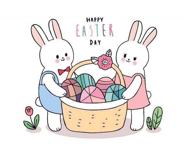 Desenhos animados bonitos coelhos do dia de páscoa e ovos coloridos na cesta.