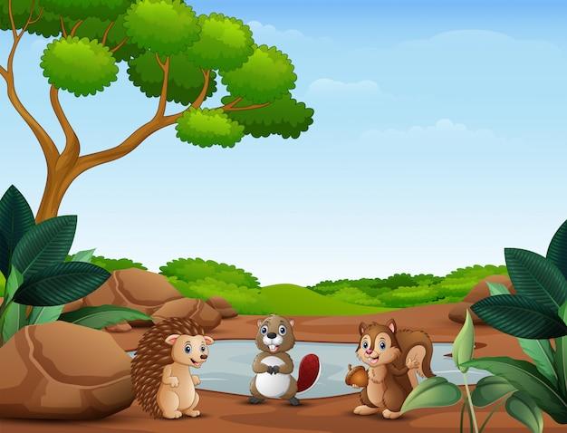Desenhos animados de animais em pé perto do pequeno lago