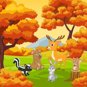 Desenhos animados de animais felizes com fundo de floresta de outono