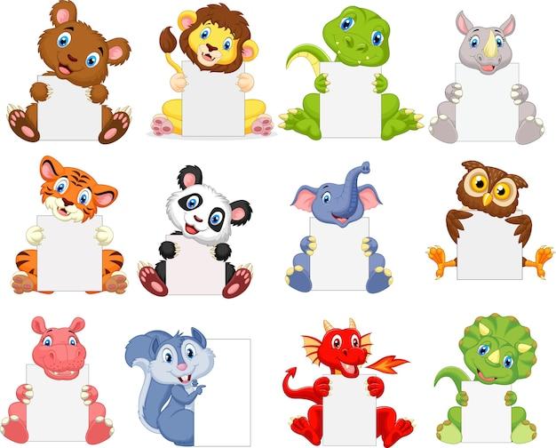 Desenhos animados de animais selvagens segurando cartaz em branco
