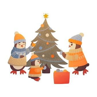 Desenhos animados de pinguins decorados com árvore de natal