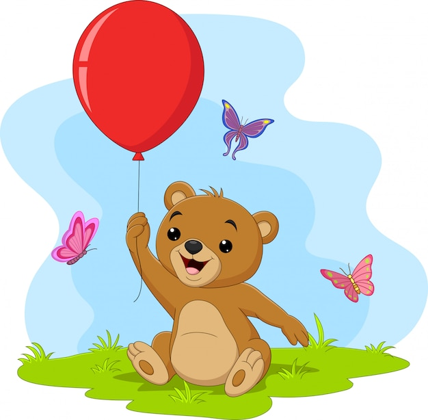 Desenhos animados ursinho segurando balão vermelho