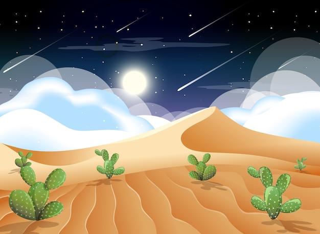 Deserto com montanhas de areia e paisagem de cactos à noite