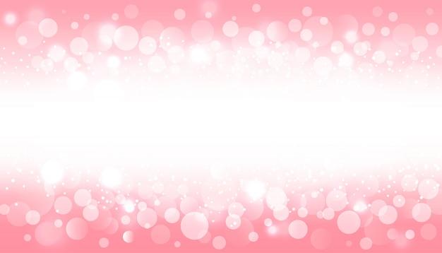 Desfocar o efeito de luz bokeh em fundo rosa