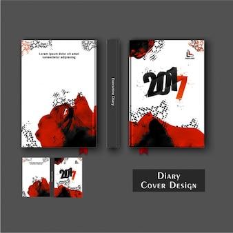 Design da capa do diário com manchas pretas e vermelhas