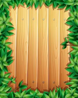 Design de borda com folhas verdes na parede de madeira