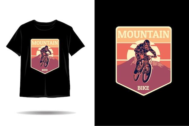 Design de camiseta com silhueta de mountain bike