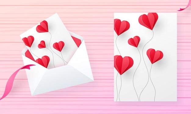 Design de cartão de dia dos namorados decorado com coração de papel