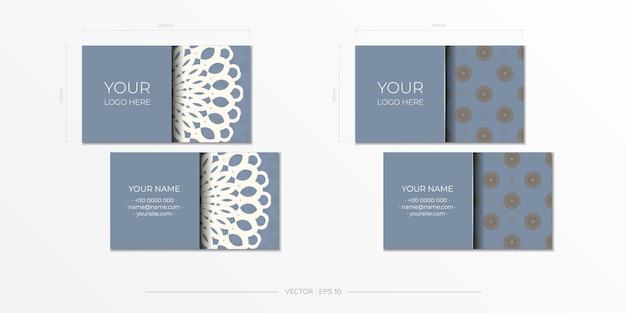 Design de cartão de visita azul pronto para imprimir com padrões luxuosos. modelo de cartão de visita de vetor com ornamentos vintage.