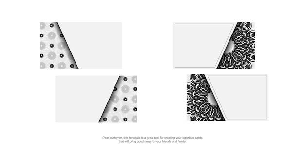 Design de cartão de visita cores brancas com mandalas. cartões de visita elegantes com um lugar para o seu texto e enfeites pretos.