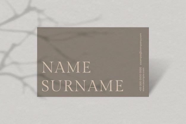 Design de cartão de visita de luxo em tom marrom