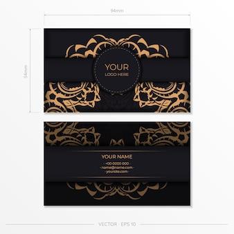 Design de cartão de visita de luxo preto com ornamentos vintage de ouro.