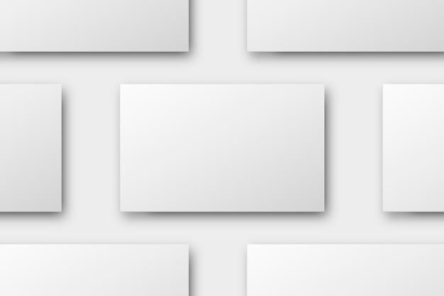 Design de cartão de visita em branco em tom branco flatlay