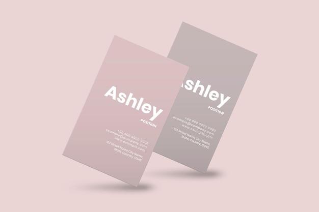 Design de cartão de visita em tom rosa com vista frontal e traseira