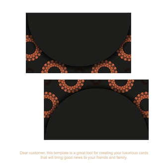 Design de cartão de visita preto pronto para impressão com padrões laranja. modelo de cartão com lugar para o seu texto e ornamento vintage.