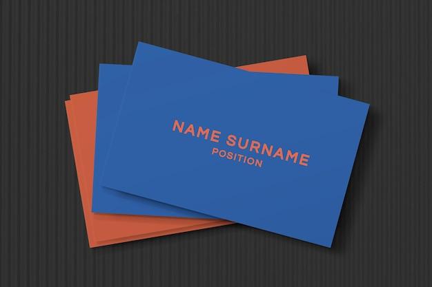Design de cartão de visita simples em azul e laranja com vista frontal e traseira