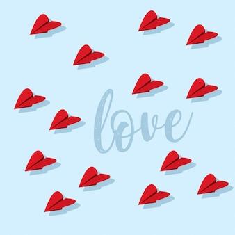 Design de cartão doce dia dos namorados com corações de avião de papel
