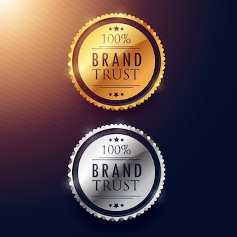 Design de etiquetas confiança na marca em ouro e prata