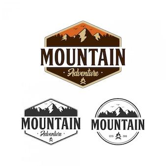 Design de logotipo de distintivo de aventura de montanha