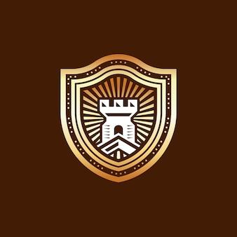 Design de logotipo de escudo de castelo dourado
