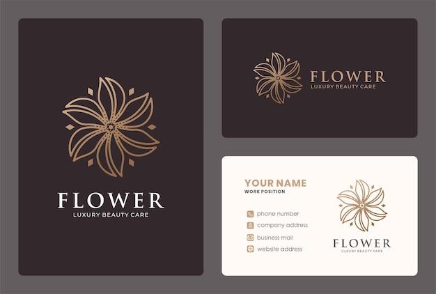 Design de logotipo de flor linear com cor dourada.