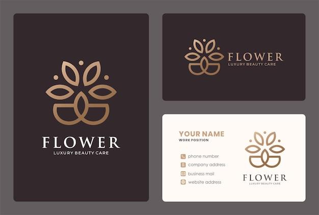 Design de logotipo de flor mínima com cor dourada.