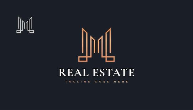 Design de logotipo de imóveis de luxo em ouro com a letra inicial m. design de logotipo de construção, arquitetura ou edifício