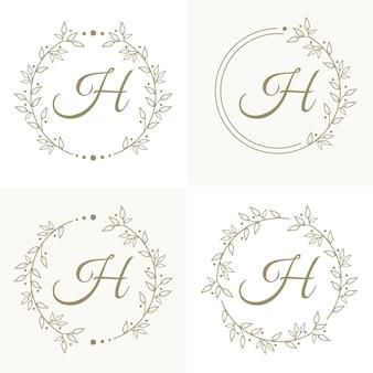 Design de logotipo de letra h de luxo com modelo de fundo de moldura floral