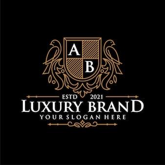 Design de logotipo de pássaro ornamental de luxo