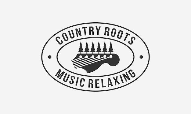 Design de logotipo do carimbo de músico country com o elemento de guitarra e árvore.