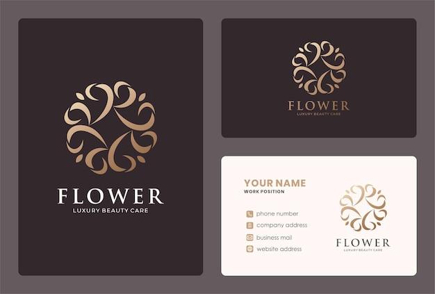 Design de logotipo elegante flor abstrata em uma cor dourada. Vetor Premium