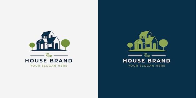 Design de logotipo em estilo espaço negativo de casa