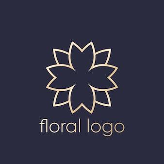 Design de logotipo floral, dourado no escuro