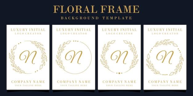 Design de logotipo luxuoso da letra n com moldura floral