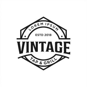 Design de logotipo vintage tap & grill