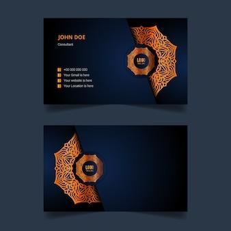 Design de modelo de cartão de visita de luxo com fundo de mandala de arabesco dourado
