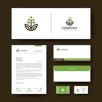 Design de modelo de identidade corporativa editável com envelope, cartão de visita e papel timbrado.