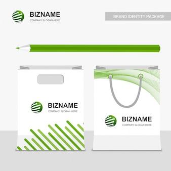 Design de sacos de compras da empresa com logotipo vector