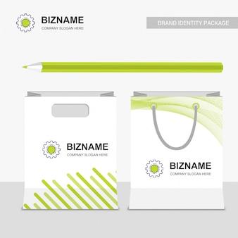 Design de sacos de compras da empresa com vetor de logotipo de engrenagem