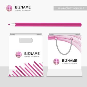 Design de sacos de compras de negócios com vetor de logotipo do mundo