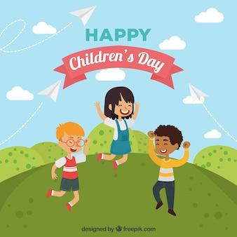 Design do dia das crianças com crianças dançando na colina