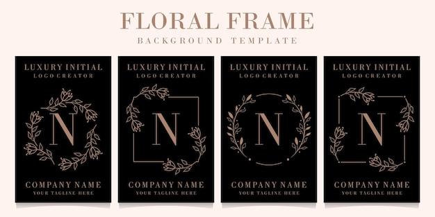 Design do logotipo da letra n de luxo com modelo floral de fundo