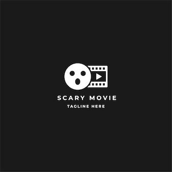 Design do logotipo do filme assustador. filme de rolo com máscara facial e tira de filme